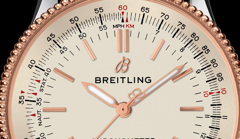The red gold hands, hour markers and logo of Breitling are in a striking contrast to the silver dial.